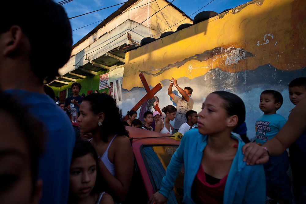 "Faithful perform during the ""Via Crucis"" (Way of the Cross) procession, which commemorates Jesus Christ's Crucifixion during Holy Week in the barrio El Nazareno in Petare, Caracas. Friday, April 10, 2009. Holy Week commemorates the last week of the earthly life of Jesus Christ culminating in his crucifixion on Good Friday and his resurrection on Easter Sunday. (Photo/Ivan Gonzalez)"