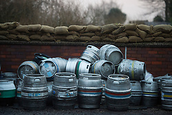 © Licensed to London News Pictures. 28/12/2015. Cawood, UK. Beer barrels protected behind sandbags and a flood defence wall in the town of Cawood in North Yorkshire where flood water and rising tides have threatened the town on December 28, 2015. Several warnings of risk to life are sill in place in parts of Lancashire and Yorkshire where rainfall has been unusually high, causing heavy flooding. Photo credit: Ben Cawthra/LNP