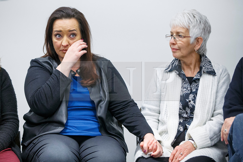 © Licensed to London News Pictures. 27/03/2017. London, UK. US tourists Mellisa Payne Cochran's sister Angela (L) weeps and Mellisa Payne Cochran's mother Sandra (R) hold hands during a press conference at New Scotland Yard in Westminster, London on 27 March 2017. Mellisa's husband Kurt Cochran was one of five people killed and Mellisa Payne Cochran was one 40 people injured in the Westminster terror attack, when 52-year-old Briton Khalid Masood drove a car at pedestrians on Westminster Bridge. Photo credit: Tolga Akmen/LNP