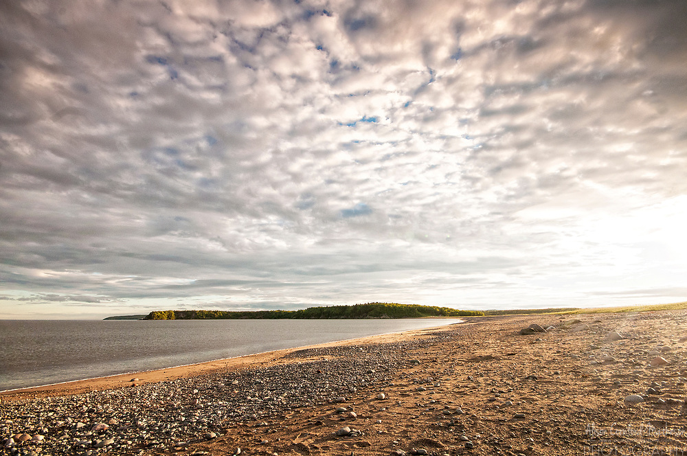 Saints Rest Beach, in Saint John, at sunset with the Irving Nature Park in the background.