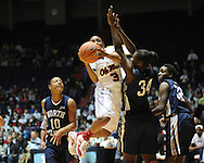 "Ole Miss's Valencia McFarland (3) scores vs. North Florida's Brittany Kirkland (10), Raneisha Lamar (34), and Octavia Langston (32) at the C.M. ""Tad"" Smith Coliseum in Oxford, Miss. on Friday, November 11, 2011."