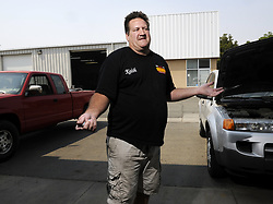 March 24, 2019 - Fresno, CA, USA - Keith Erwin, owner of Keith?s Automotive along Golden State Boulevard north of Shaw Avenue, lamented the eminent domain process in a 2013 interview. He was able to stay on the property by relocating to another building that was far enough back to be clear of the construction - for now. (Credit Image: © Eric Paul Zamora/Fresno Bee/TNS via ZUMA Wire)