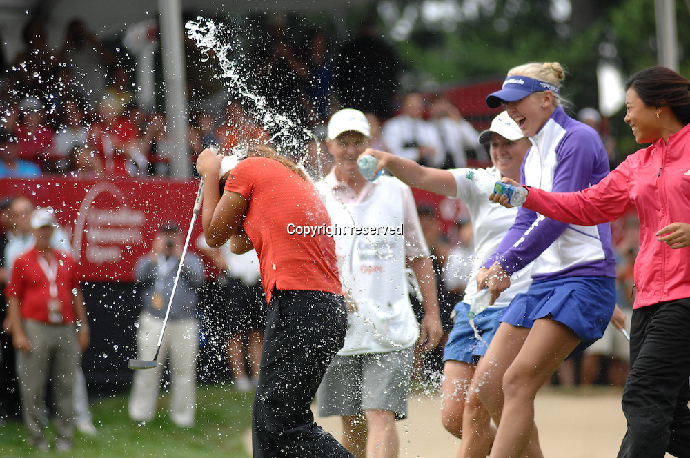 26.08.2012. Coquitlam  British Columbia, Canada.  Fifteen Year Old Lydia KO Front l of New Zealand is Sprayed with soda After Winning The LPGA Golf women Canadian Women s Open Golf Tournament AT The Vancouver Golf Club in Coquitlam B C ON Aug 26 2012 Lydia KO became The youngest Player to Win A LPGA Golf women Tour Event