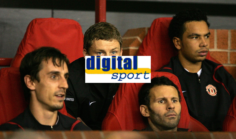 Photo: Paul Thomas.<br /> Manchester United v FC Copenhagen. UEFA Champions League, Group F. 17/10/2006.<br /> <br /> Ole Gunnar Solskjaer (C) sits on the bench with (L-R)players Gary Neville, injured Ryan Giggs and Keiran Richardson.