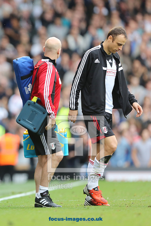 Picture by Richard Calver/Focus Images Ltd +447792 981244<br /> 05/10/2013<br /> Dimitar Berbatov of Fulham leaving the pitch, after earlier being substituted due to a injury during the Barclays Premier League match at Craven Cottage, London.