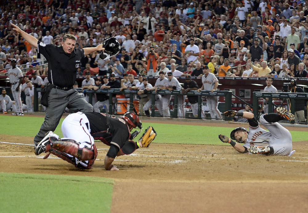 PHOENIX, AZ - JUNE 08:  Hunter Pence #8 of the San Francisco Giants is called safe at home plate on a throwing error made by catcher Miguel Montero #26 of the Arizona Diamondbacks in the second inning at Chase Field on June 8, 2013 in Phoenix, Arizona.  (Photo by Jennifer Stewart/Getty Images) *** Local Caption *** Hunter Pence; Miguel Montero