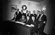09/06/1967<br /> 06/09/1967<br /> 09 June 1967<br /> Esso and Unions sign a Productivity Agreement. the agreement was between Esso Petroleum Company (Ireland) Ltd and the Irish Transport and General Workers Union; the Amalgamated Transport and General Workers Union and the Amalgamated Engineering Union. Picture shows Mr. J.H. Donvan (2nd from left) Managing Director Esso (Ireland) Ltd. signing the agreement watched by officials from the three unions, who also signed on behalf of their respective unions. From left: Mr. Chris Kirwan, National Group Secretary, I.T.&G.W.U.; Mr. Donovan; Mr. Charles Douglas, Branch Secretary, A.T. & G.W.U. and Mr. Timothy Keane, National Organiser, A.E.U..Back row l-r: S.C. O'Flaherty, Esso (Ireland) Ltd; Mr. Walter McFarlane, Branch Secretary I.TG.W.U.; Mr Brendan Martin, Director, Esso (Ireland) Ltd.; Mr. Matt Merrigan, District Secretary, A.T.G.W.U.; Mr. Norman Kennedy, Irish Secretary, A.T.G.W.U.; Mr. Richard Walsh, Branch Secretary, A.E.U. and Mr. Edward Brown, Vice-President I.T.G.W.U.
