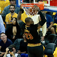 12 June 2017: Cleveland Cavaliers forward LeBron James (23) dunks the ball during the Golden State Warriors 129-120 victory over the Cleveland Cavaliers, in game 5 of the 2017 NBA Finals, at the Oracle Arena, Oakland, California, USA.