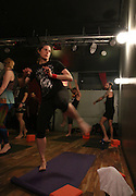 NEW YORK CITY, NEW YORK, MARCH 30, 2016. Caryn Havlik about to kick the wall in Metal Bones Yoga. The class takes place at 6:30 p.m. on Wednesdays at The Cobra Club in Bushwick, Brooklyn. 03/30/2016. Photo by Donna M. Airoldi/NYC News Service
