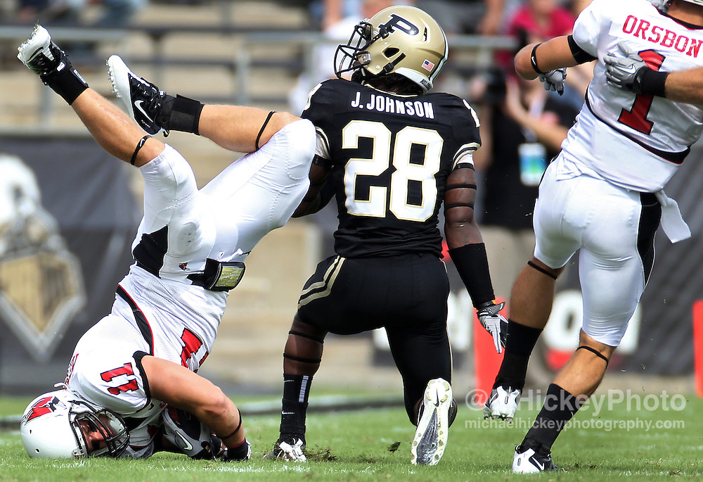 Action photography of Ball State Cardinals vs/ Purdue Boilermakers at Ross-Ade Stadium in West Lafayette, Indiana...Sports photography by Michael Hickey