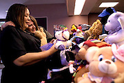 Fremont, CA. - 8/14/03 - Karen Kadaja, who started The One Bear Project, Jean Morgan from Tri-City Homeless Coalition, and Bank of the West, gathered a collection of bears and other friends at the bank in Fremont, to be donated to children in the community.