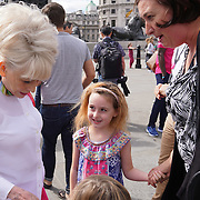 London,England,UK, 8th Aug 2016 : Dame Barbara Windsor DBE Join Mayor's Team London Ambassadors to show London is open to all. London is Open - Team London Ambassadors are out at key tourist locations across the capital this summer, welcoming visitors from around the world and providing them with information and local knowledge in Trafalgar square,London,UK. Photo by See Li