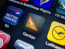 detail of Qantas airline app icon on iPhone screen