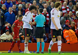 LIVERPOOL, ENGLAND - Thursday, March 10, 2016: Manchester United's Marouane Fellaini argues with the referee Carlos Velasco Carballo during the UEFA Europa League Round of 16 1st Leg match against Liverpool at Anfield. (Pic by David Rawcliffe/Propaganda)