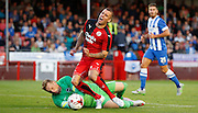 Jimmy Smith tumbles under the challenge from David Stockdale during the Pre-Season Friendly match between Crawley Town and Brighton and Hove Albion at the Checkatrade.com Stadium, Crawley, England on 22 July 2015. Photo by Michael Hulf.