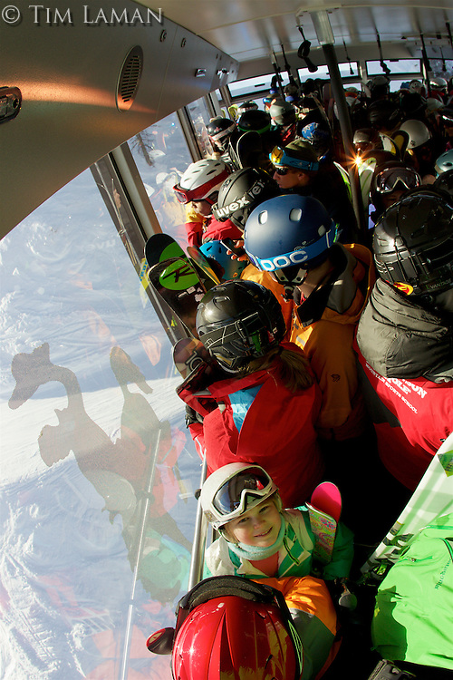 Jessica Laman (age 9), is the smallest person on the tram to the summit of Rondevouz Mountain at Jackson Hole, Wyoming