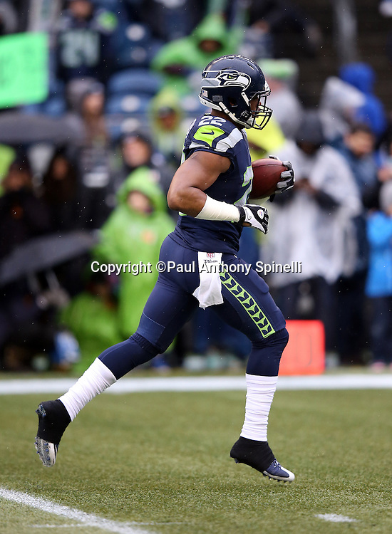 Seattle Seahawks running back Fred Jackson (22) runs with the ball while warming up before the 2015 NFL week 16 regular season football game against the St. Louis Rams on Sunday, Dec. 27, 2015 in Seattle. The Rams won the game 23-17. (©Paul Anthony Spinelli)