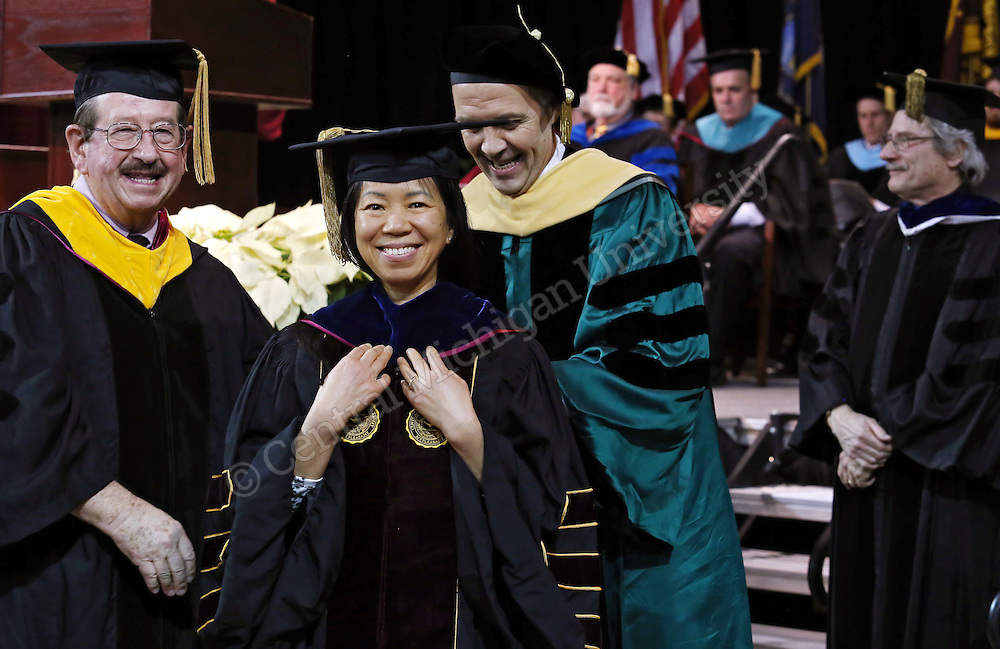 Doctoral hooding during the December 2015 Commencement photo by Emily Mesner