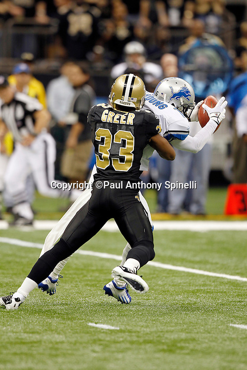 New Orleans Saints cornerback Jabari Greer (33) tackles Detroit Lions wide receiver Titus Young (16) after a first down catch on the Lions first drive during the NFL wildcard playoff football game against the Detroit Lions on Saturday, January 7, 2012 in New Orleans, Louisiana. The Saints won the game 45-28. ©Paul Anthony Spinelli