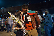 Amadores de Merced's Antonio Melo with girlfriend Britanie Melo after grabbing the bull during the bloodless bullfight in Gustine, June 30, 2014.
