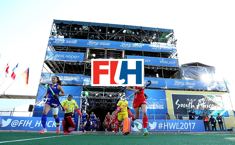 JOHANNESBURG, SOUTH AFRICA - JULY 12:  Shihori Oikawa of Japan and Alex Danson of England lead their teams out during day 3 of the FIH Hockey World League Semi Finals Pool A match between Japan and England at Wits University on July 12, 2017 in Johannesburg, South Africa.  (Photo by Jan Kruger/Getty Images for FIH)