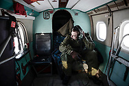 Canadian Air Forces corporal Ryan Wood, flight engineer, on board a Squadron 440 ski-equiped Twin Otter during a supply flight to a Rangers patrol during Nunalivut 2012. 16 April 2012.