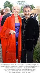 MR & MRS EDDIE JORDAN owner of the Jordan F1 racing team, t the Chelsea Flower Show in London on 20th May 2002.PAE 18