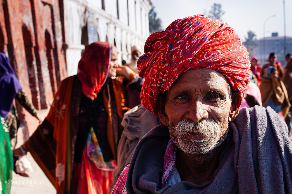 A man from southern Nepal  smiles whiles visiting the Pashupatinath temple near Kathmandu, Nepal.