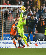 30th August 2019; Dens Park, Dundee, Scotland; Scottish Championship, Dundee Football Club versus Dundee United; Benjamin Siegrist of Dundee United punches clear from Kane Hemmings of Dundee