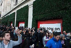 Boxing Day Sales. Shoppers queue outside Selfridges department store on Boxing Day. Shoppers flock to the traditional Boxing Day sales in London to search the best post-Christmas sales. Selfridges, London, United Kingdom. Thursday, 26th December 2013. Picture by Peter Kollanyi / i-Images