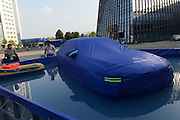 JINHUA, CHINA - OCTOBER 22: (CHINA OUT)<br /> <br /> A blue life jacket designed for a car is seen at International Expo Center on October 22, 2014 in Jinhua, Zhejiang province of China. A blue life jacket designed for a car is shown at the 20th China Yiwu International Commodities Fair. The life jacket encases a car within five minutes by pulling up zipper and will float on water when the ponding reaches to 55 centimeters. <br /> ©Exclusivepix