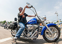 Riders were all smiles as Tuesday brought another banner day for Laconia's 91st Motorcycle Rally.  (Karen Bobotas/for the Laconia Daily Sun)