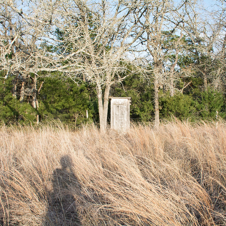 The outhouse is the remaining structure at Cedar Creek Cemetery