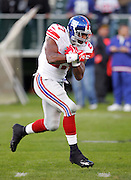 OAKLAND, CA - DECEMBER 31:  Brandon Jacobs #27 of the New York Giants catches a pregame pass during warmups against the Oakland Raiders at McAfee Coliseum on December 31, 2005 in Oakland, California. The Giants defeated the Raiders 30-21. ©Paul Anthony Spinelli *** Local Caption *** Brandon Jacobs