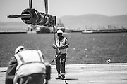 Black and White image of the Spreader Beam being moved to the vessel for launch
