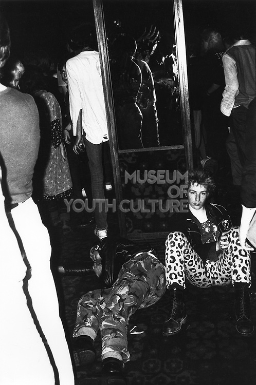 A punk sat down at a Siouxsie and the Banshees gig, Bristol, UK, 1980.