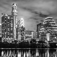 2016 Austin skyline at night black and white photo with buildings along the Colorado river in the Southwestern United States of America.