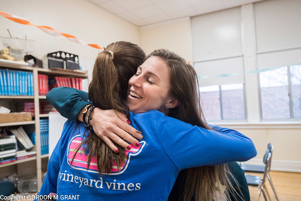 Cara Nelson, a seventh grade social studies teacher at East Hampton Middle School, gets a hug from one of her students upon returning from her recent trip that involved running seven marathons in seven days on seven continents, in East Hampton, Feb. 7, 2018. This was Nelson's first day back to school after finishing her last marathon on Monday in Miami.
