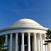 The dome of the Jefferson Memorial against a clear blue sky with copyspace at the top of frame.