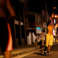 Teen neighbors play football on a parallel street to Trump Plaza casino on September 4, 2014.  Four casinos have already or will be closing in the near future, including Trump Plaza on September 16, resulting in the loss of thousands of jobs.