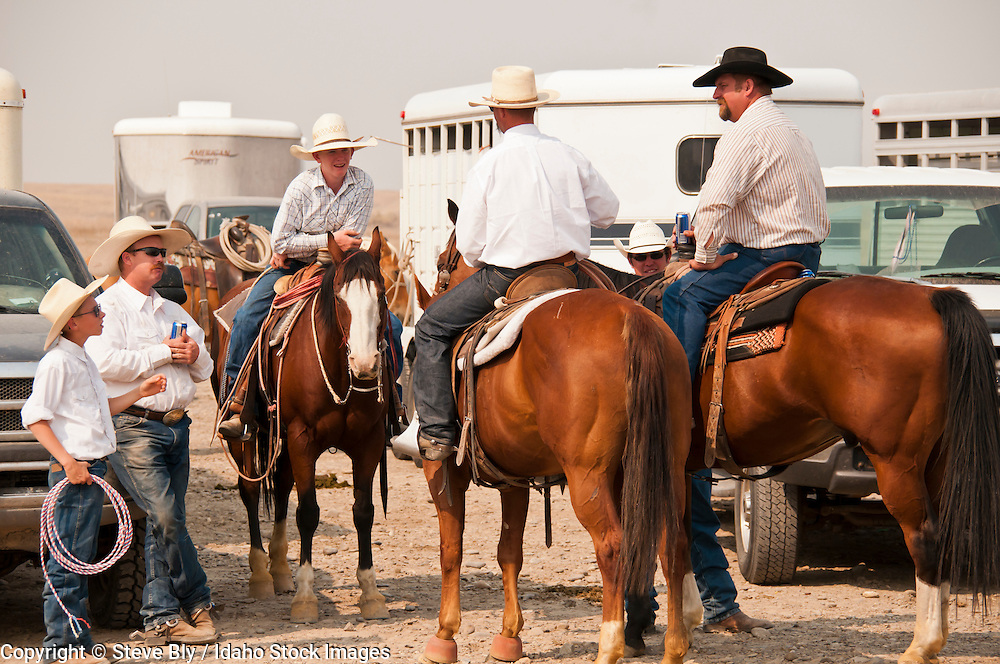 Cowboys on saddle horses getting ready for the Rodeo, Bruneau, Idaho, USA