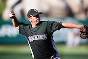 ANAHEIM, CA - JUNE 24:  Third baseman Garrett Atkins #27 of the Colorado Rockies throws to first base during batting practice before the game against the Los Angeles Angels of Anaheim at Angel Stadium on Wednesday, June 24, 2009 in Anaheim, California.  The Angels defeated the Rockies 11-3.  ©Paul Anthony Spinelli*** Local Caption *** Garrett Atkins