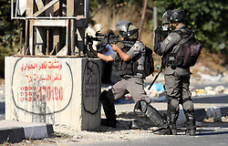 16.10.2015, Nablus, PSE, Gewalt zwischen Palästinensern und Israelis, im Bild Zusammenstösse zwischen Palästinensischen Demonstranten und Israelischen Sicherheitskräfte // Members of Israeli security forces aim at Palestinian protesters during clashes at the Israeli Hawara checkpoint near the West Bank city of Nablus October 16, 2015. The unrest that has engulfed Jerusalem and the occupied West Bank, the most serious in years, has claimed the lives of 35 Palestinians and seven Israelis. The tension has been triggered in part by Palestinians' anger over what they see as increased Jewish encroachment on Jerusalem's al-Aqsa mosque compound, Palestine on 2015/10/16. EXPA Pictures © 2015, PhotoCredit: EXPA/ APAimages/ Nedal Eshtayah<br /> <br /> *****ATTENTION - for AUT, GER, SUI, ITA, POL, CRO, SRB only*****
