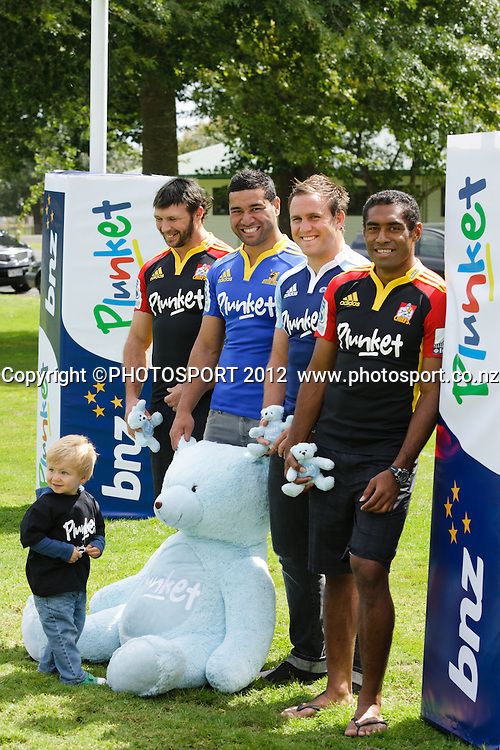 Scott Waldrom (Chiefs) with son Bair (22 months), Siale Piutau (Highlanders) James Parsons (Blues) and Asaeli Tikoirotuma (Chiefs) at jersey sponsorship swap, where BNZ's key sponsorship logo placement on jerseys will be replaced by the charity Plunket at two Super Rugby franchise games this weekend. Pictured at the Chiefs' base, Ruakura Campus, Innovation Park, Hamilton, New Zealand, Thursday 1 March 2012. Photo: Stephen Barker/PHOTOSPORT