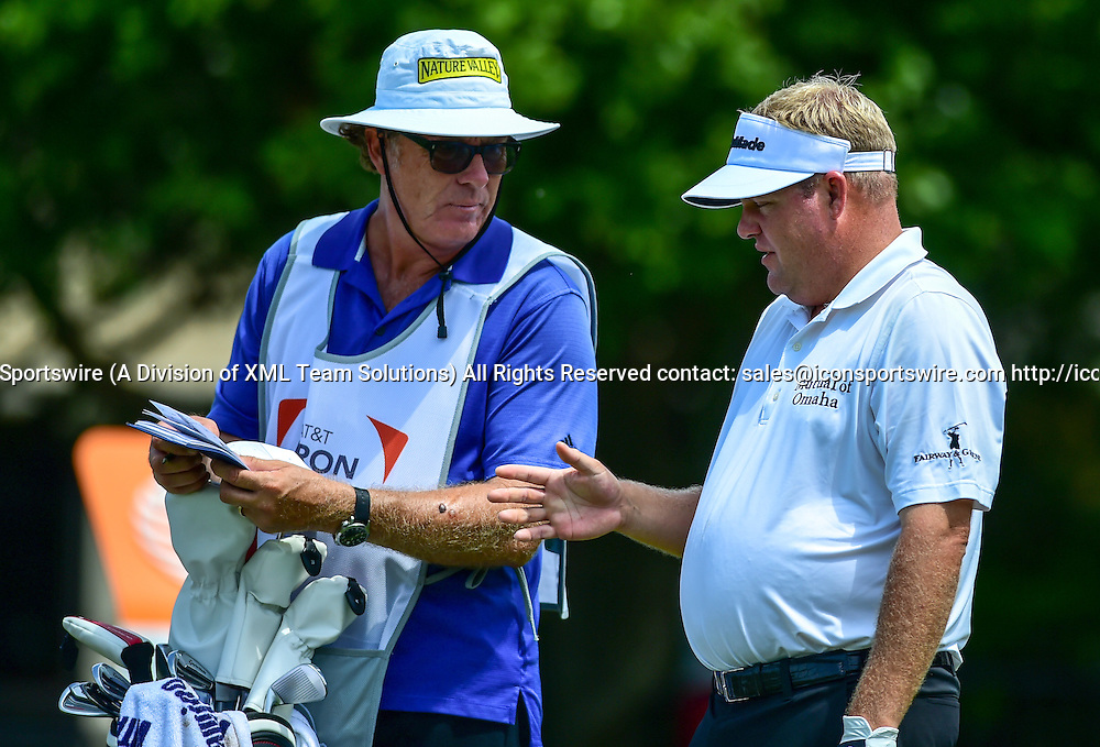 May 28, 2015: Carl Pettersson discusses his tee shot with his caddie on #17 during first round action of the AT&T Byron Nelson Championship at TPC Four Seasons in Irving, Texas.