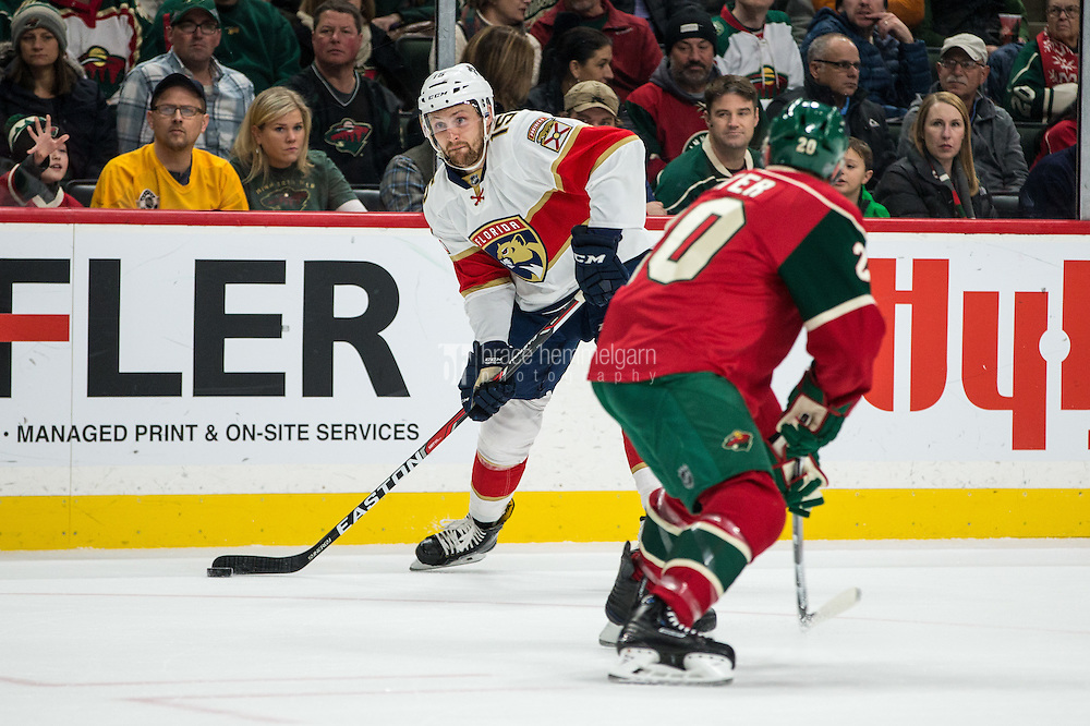 Dec 13, 2016; Saint Paul, MN, USA; Florida Panthers forward Paul Thompson (15) shoots during the first period against the Minnesota Wild at Xcel Energy Center. Mandatory Credit: Brace Hemmelgarn-USA TODAY Sports