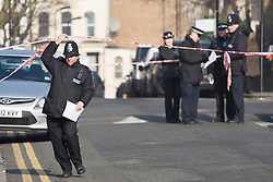 © licensed to London News Pictures. London, UK 17/02/2013. Police officers in Hindrey Road, Clapton, east London, where a 19-year-old teenager died after being gunned down at 8.20pm on Saturday 16 February 2013. Photo credit: Tolga Akmen/LNP