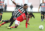 Nacional´s player Zainadine (L ) fights for the ball with Benfica's player Renato Sanches   (R ) during Portuguese First League football match Nacional vs Benfica  held at Madeira Stadium, Funchal, 11 January 2016.  LUSA / GREGORIO CUNHA