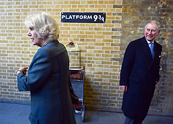 "© Licensed to London News Pictures. 30/01/2013. London, UK HRH Their Royal Highnesses look at the Harry Potter tourist attraction at ""Platform 9 3/4"" The Prince of Wales and HRH The Duchess of Cornwall visit Kings Cross St Pancras Station in London today 30th January 2013. They were carrying out engagements to celebrate London Underground's 150th anniversary. Photo credit : Stephen Simpson/LNP"
