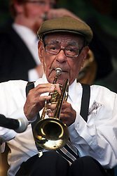 05 May 2012. New Orleans, Louisiana,  USA. <br /> New Orleans Jazz and Heritage Festival. <br /> 100 year old jazz trumpeter Lionel Ferbos performs with the 'Preservation Hall and Friends' ensemble. <br /> Photo; Charlie Varley